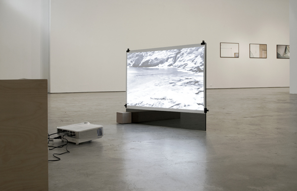 Installation View: We Glow! 2016 HD video, 9:45 min. Colour, Stereo Sound Video installation, headphone, HD projector, wood bench, black glass, water colour paper, wood stand, clips, Dimensions variable Solo Show At Ileana Tounta Gallery, Athens, Greece