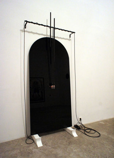 Make me believe I am not going to die, 2010 Glass, wires, light bulbs, marble, iron Dimensions variable