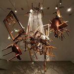 R.E., 2012 Tables, chairs, glasses, plates, cutlery, expanding foam, wire, crystals, iron Dimensions variable